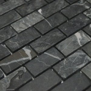 Мрамор черный галтованный 23х48 фото